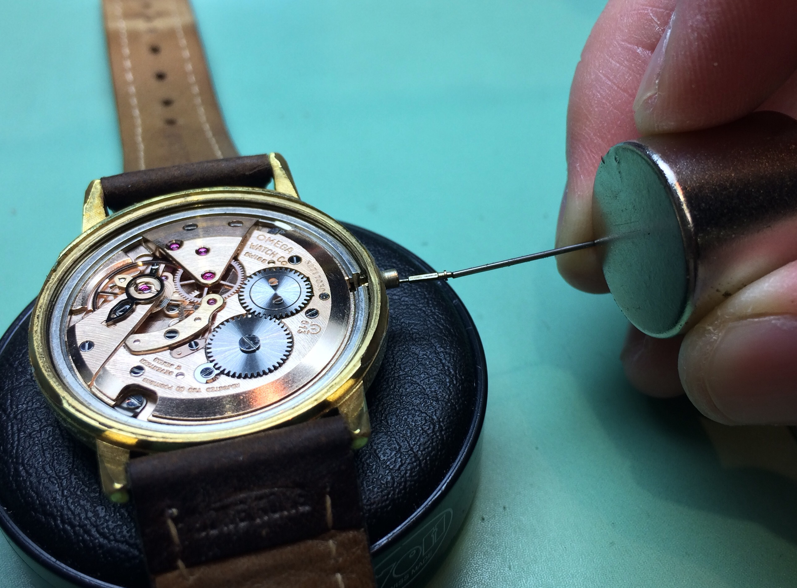 Removing a broken stem from a vintage Omega using a magnet